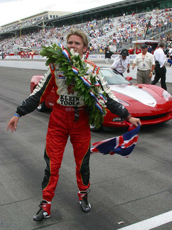 Dan Wheldon enjoys the victory