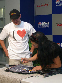 Danica Patrick signs a wing in the presence of Tomas Enge