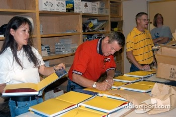 Jeri and Bobby Unser and Jason Tanner signing copies of Gordon Kirby's new
