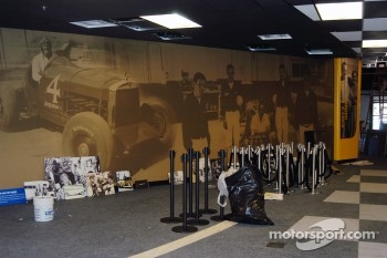 Wallpapered perimeter of Jerry's Garage awaiting mounting of photos