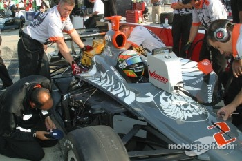 Tomas Scheckter waits while his crew works on the car