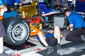 Checking under Buddy Lazier's car