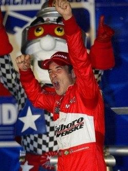 Race winner Helio Castroneves celebrates