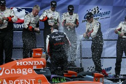Victory lane: Dario Franchitti celebrates the win and the 2007 IndyCar Series championship with Andretti Green Racing crew members
