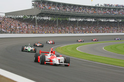 Pace laps: Helio Castroneves leads the field around