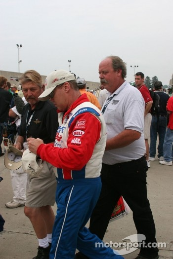 Al Unser Jr. signs autographs during the rain delay