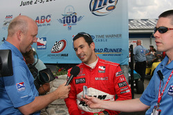 Pole winner Helio Castroneves speaks with the media
