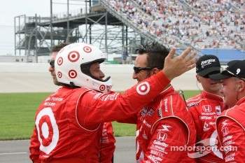 Chip Ganassi Racing crew members celebrate the victory of Scott Dixon