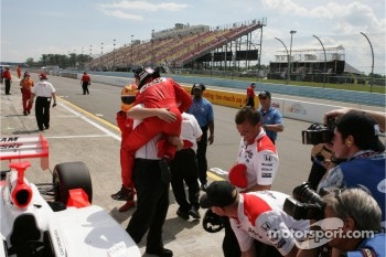 Polesitter Helio Castroneves celebrates
