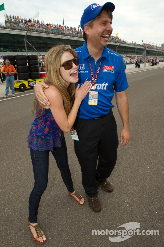 Oriol Servia's girlffriend Jaclyn Becker celebrates as Oriol Servia sets the fastest qualifying speed