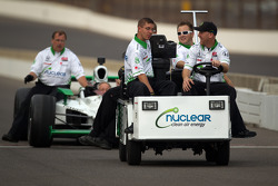 Nuclear Clean Air Energy HVM Racing team members bring the backup car of Simona de Silvestro