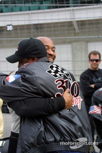 George Mack receives a big hug for successfully completing the 2002 Indianapolis 500 rookie orientation program