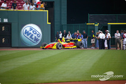 Visit at a Cincinnati Reds baseball game: Scott Sharp drives the 2-seater car onto the field