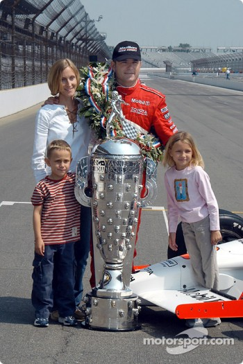 Gil de Ferran and family pose with Borg Warner Trophy