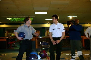 Sam Hornish Jr. at PBA Pro-Am in Indianapolis: PBA legend Mike Aulby gives pointers to Sam Hornish Jr.