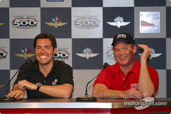 Larry Foyt and Al Unser laugh as Larry explains the family tree