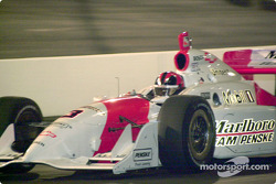 Helio Castroneves comes into the pits