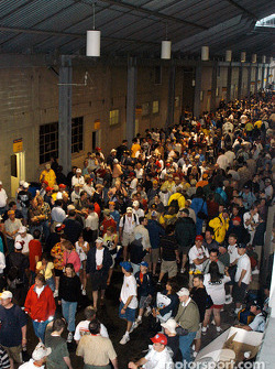The crowd takes shelter during the morning rainout