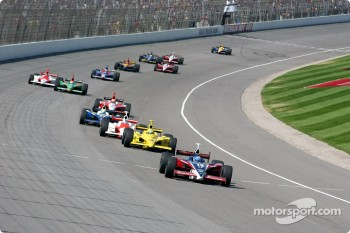 Buddy Rice leads a group of cars