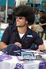 Alex Tagliani presenting his new hairdo