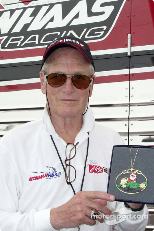 Legendary actor and Newman/Haas Racing CART team co-owner Paul Newman with the 2001 CARA Charities Christmas Ornament that he designed