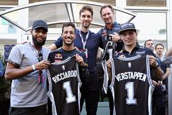Daniel Ricciardo, Red Bull Racing, Max Verstappen, Red Bull Racing and Christian Horner, Red Bull Racing Team Principal are given San Antonio Spurs jerseys by San Antonio Spurs basketball players Patty Mills and Pau Gasol