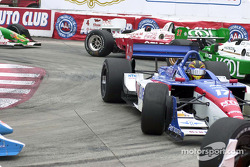 Oriol Servia trying to avoid Alex Tagliani