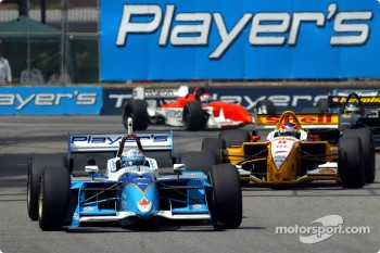 Alex Tagliani leading Jimmy Vasser