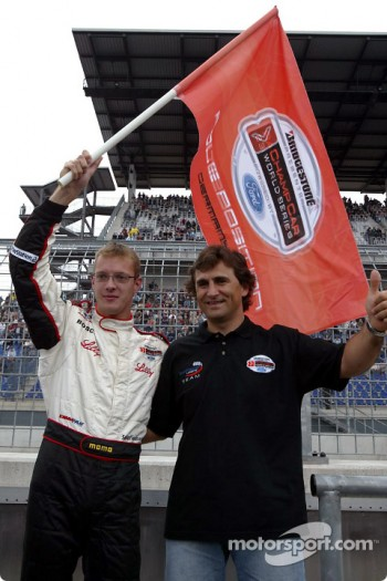 Alex Zanardi presents Sbastien Bourdais with the pole position flag