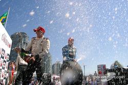 The podium: champagne for Paul Tracy, Bruno Junqueira and Sébastien Bourdais
