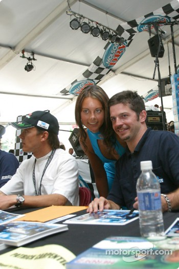 Drivers autograph session: Patrick Carpentier poses