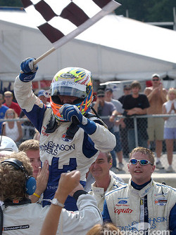 Race winner Alex Tagliani celebrates
