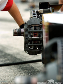 Newman-Haas crew member works on the brakes
