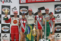 Podium: race winner Bruno Junqueira with Sébastien Bourdais and Mario Dominguez
