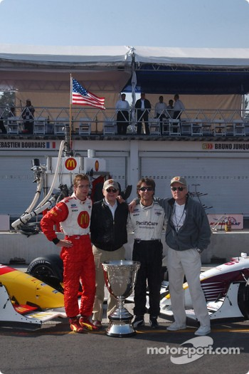 The contenders for the Vanderbilt Cup: pole winner Sbastien Bourdais and Bruno Junqueira pose with Carl Haas and Paul Newman