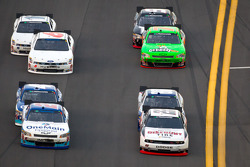 Brad Keselowski, Penske Racing Dodge and Elliott Sadler, Kevin Harvick Inc. Chevrolet lead a group of cars