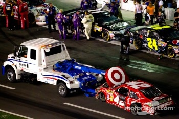 Car of Juan Pablo Montoya, Earnhardt Ganassi Racing Chevrolet towed back to the garage