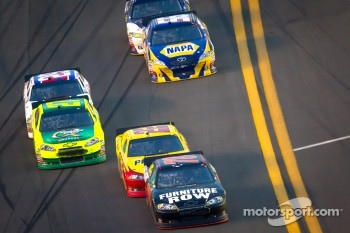 Regan Smith, Furniture Row Racing Chevrolet leads Kurt Busch, Penske Racing Dodge