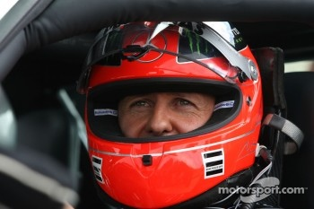 Michael Schumacher, Mercedes GP drives a Mercedes SLS