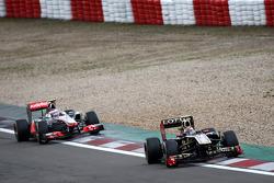 Vitaly Petrov, Lotus Renault GP leads Jenson Button, McLaren Mercedes