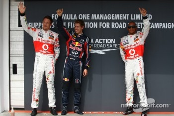 Jenson Button, McLaren Mercedes with Sebastian Vettel, Red Bull Racing and Lewis Hamilton, McLaren Mercedes and