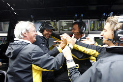 The Dams team celebrate Romain Grosjean winning the 2011 GP2 Series title