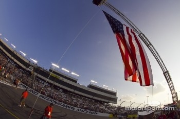 The American flag waves above the track in remembrance of September 11, 2001