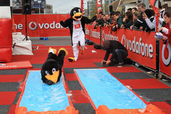 Craig Lowndes and Jamie Whincup in penguin suits in the Vodafone penguin race
