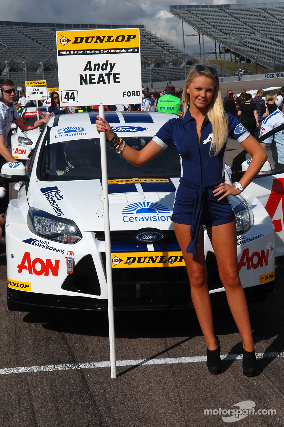 Team Aon grid girl to Andy Neate