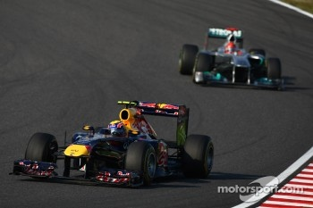 Mark Webber, Red Bull Racing leads Michael Schumacher, Mercedes GP F1 Team