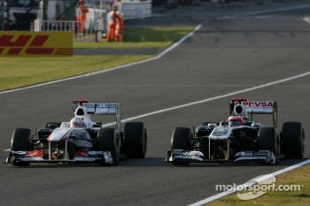 Kamui Kobayashi, Sauber F1 Team and Rubens Barrichello, Williams F1 Team