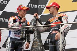Podium: race winner Casey Stoner, third place Andrea Dovizioso