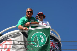 Golfer Fuzzy Zoeller is ready to wave the green flag