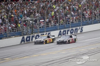 Clint Bowyer passes Jeff Burton for the win